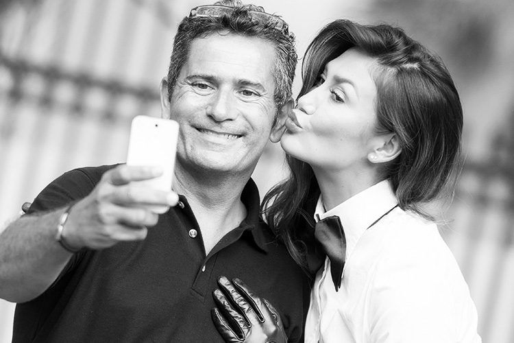 Picture of a couple taking a self picture with his smart phone